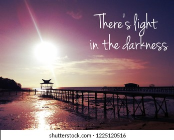 """Wording """" There's light in the darkness"""" with silhouette beautiful long exposure sunrise shot at jetty as background. Image contain certain grain or noise and soft focus when view at full resolution."""