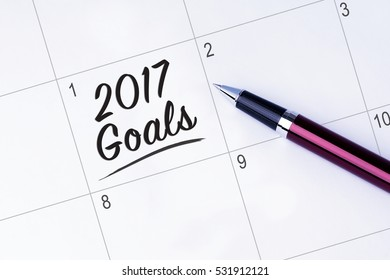 The words 2017 Goals on a calendar planner to remind you an important appointment with a pen on isolated white background. New Year concepts of goal and objective.