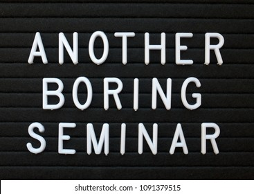 The words Another Boring Seminar in white plastic letters on a black letter board as a humorous reminder to provide content of interest to your audience