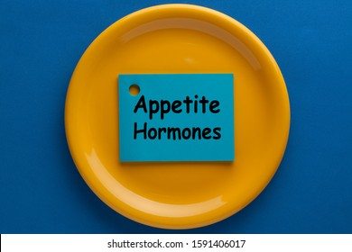 The words Appetite Hormones in sticky note on plate.