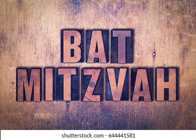 The words Bat Mitzvah concept and theme written in vintage wooden letterpress type on a grunge background.