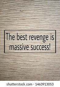 words the best revenge is massive success with wooden texture background