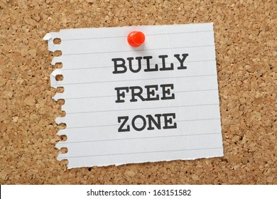The words Bully Free Zone typed on a scrap of lined paper and pinned to a cork notice board. A concept for respect and tolerance in school and at work or home.