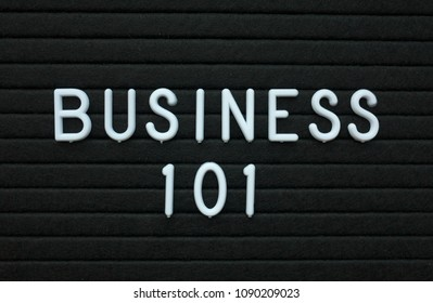 The words Business 101 in white plastic letters on a black letter board as an introduction to how to achieve success in the world of business
