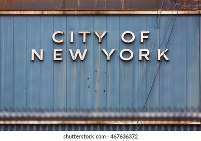 The words City of NEW YORK written old old metal fence surface