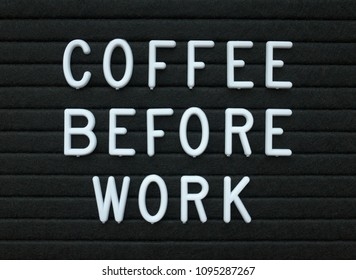 The words Coffee Before Work in white plastic letters on a black letter board as a reminder of your daily routine and preparation for the day