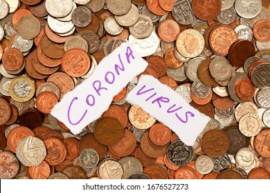 The words corona virus written in purple ink on two pieces of ripped white paper the paper is laying on top of hundreds of silver and copper coloured coins, pound sterling British currency