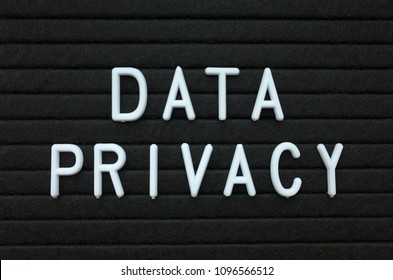 The words Data Privacy in white plastic letters on a black letter board as a reminder for when dealing with personal details and private information sharing