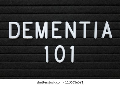The words Dementia 101 in white plastic letters on a black letter board as an introduction to mental health issues