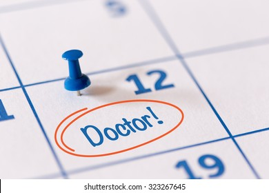 The words Doctor written on a Calendar to Remind you an Important Appointment