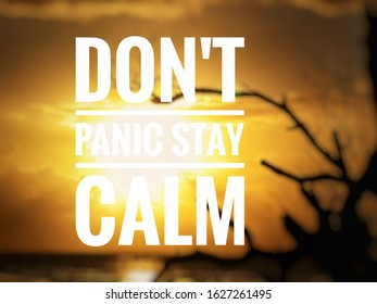"words 'dont panic, stay calm"" written on blurred background."
