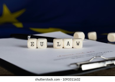 Words EU LAW composed of wooden dices. Closeup