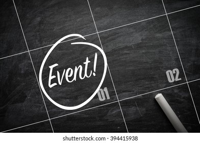 The words Event and circled on a blackboard