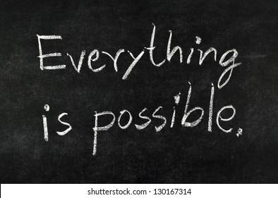 "words ""Everything is possible"" written on blackboard"