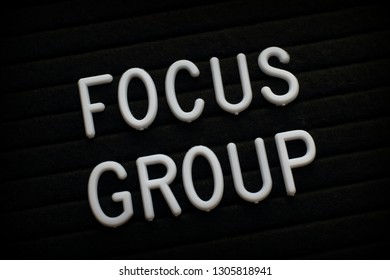 The words Focus Group in white plastic letters on a notice board