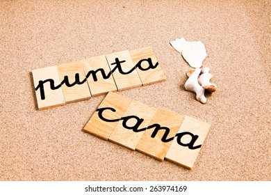 Words formed from small pieces of wood containing a sun and beach tourist destination, punta cana