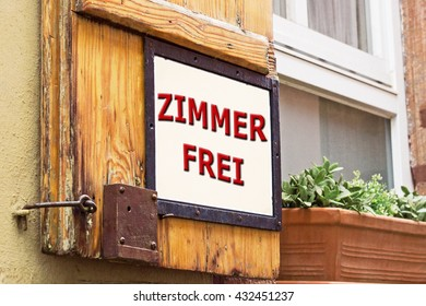 Words FREE ROOM in German on old German wooden window with shutters background , close up