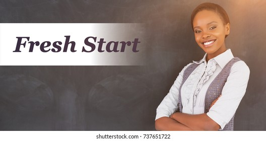Words fresh start against white background against teacher smiling with arms crossed