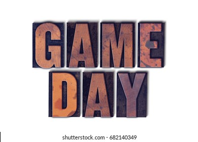 The words Game Day concept and theme written in vintage wooden letterpress type on a white background.