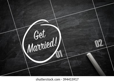 The words Get Married and circled on a blackboard