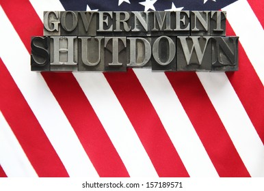 the words government shutdown on an American flag