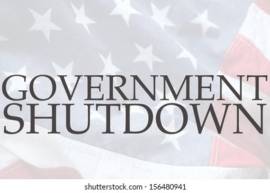 the words government shutdown on an old USA flag