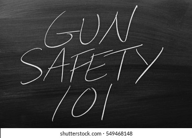 "The words ""Gun Safety 101"" on a blackboard in chalk"