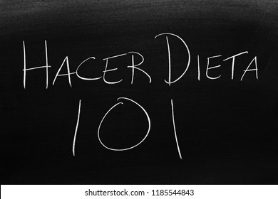 The words Hacer Dieta 101 on a blackboard in chalk.  Translation: Dieting 101