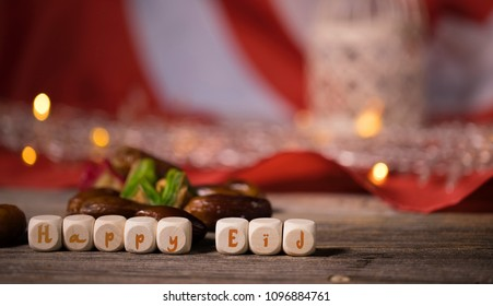 Words Happy Eid composed of wooden dices.