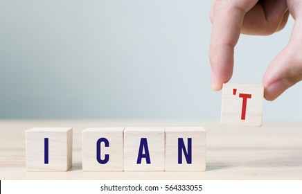 "Words ""i can"" on wood block, Concept motivational message of ability and possibility"