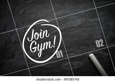 The words Join Gym and circled on a blackboard to remind important appointment