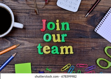 The words Join our team on wooden table