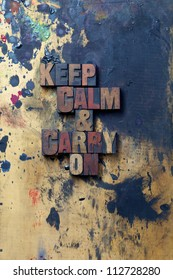 The words keep calm and carry on written in old letterpress type.