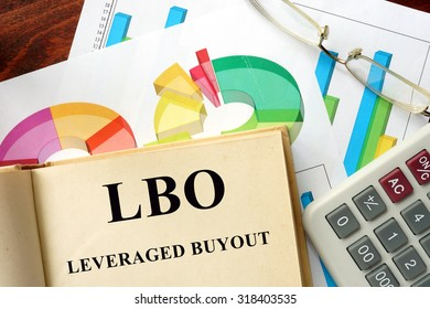 Words Leveraged Buyout - LBO written on a book. Business concept.