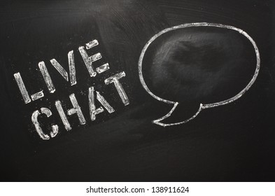The words Live Chat on a blackboard with a drawing of a speech bubble