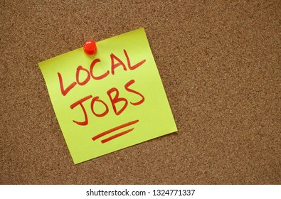 The words Local Jobs written by hand on a yellow sticky note and pinned to a cork notice board
