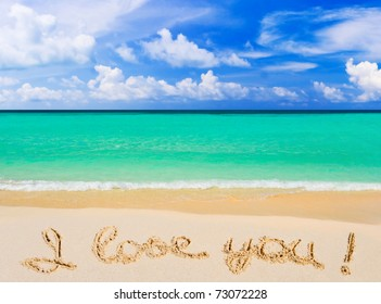 Words I Love You on beach - vacation concept background