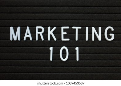 The words Marketing 101 in white plastic letters on a black letter board as a n introduction to the methods used to promote your business or idea