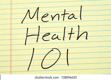 "The words ""Mental Health 101"" on a yellow legal pad"