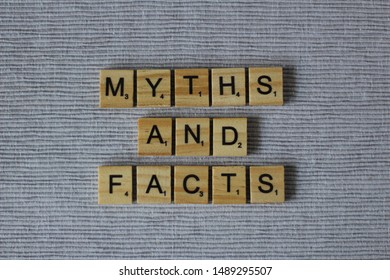 Words MYTHS AND FACTS written with Scrabble letters isolated on gray background. Concept of myths vs (versus) facts, truths and lies. Editorial image.