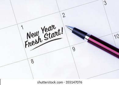 The words New Year�¢??s Fresh Start written on a calendar planner to remind you an important appointment with a pen on isolated white background.  New Year concepts of goal and objective.