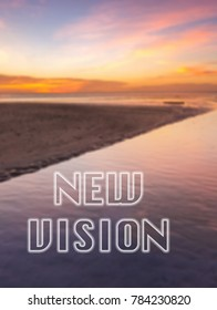 Words New vision written on blurred sunset seascape background. Motivation concept.