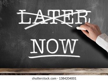 words NOW and LATER written on blackboard with LATER struck out anti procrastination concept