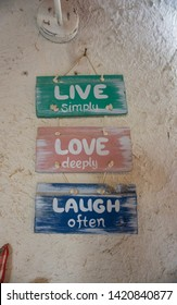 Words on plates: Live simply, love deeply, laugh often.