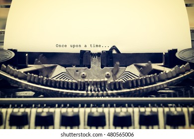 "Words ""Once upon a Time"" written with old typewriter on white paper in vintage style"