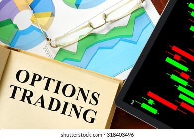 Words options trading written on a book. Business concept.