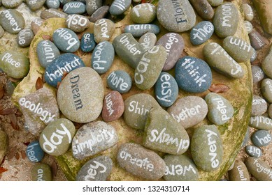 Words painted on stones in a pile