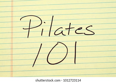 The words Pilates 101 on a yellow legal pad