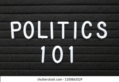 The words Politics 101 in white plastic letters on a black letter board as an introduction to the basics for learning the subject