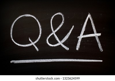 The words Q & A written by hand in white chalk on a blackboard